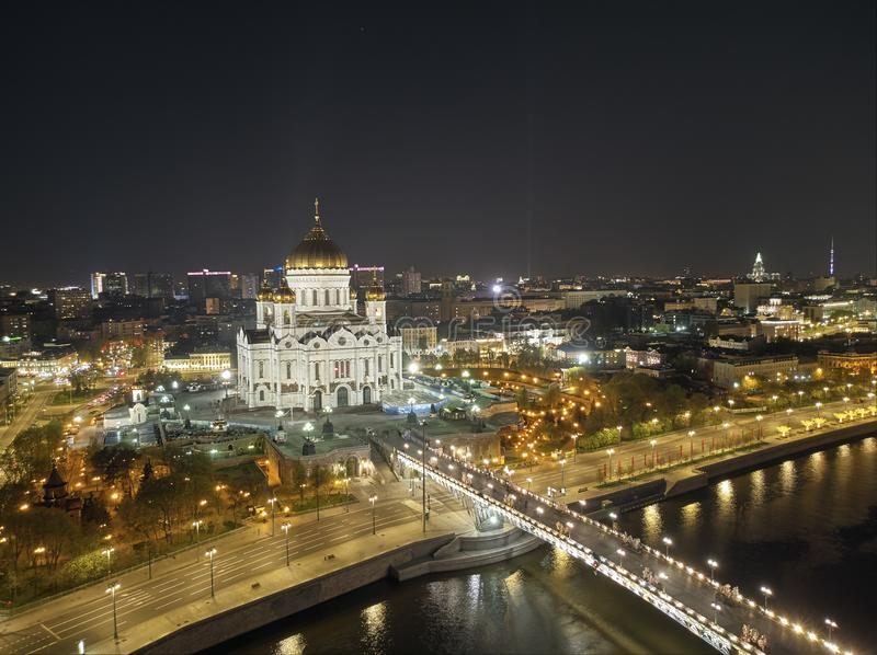 Cathedral of Christ the Savior in Moscow near river, Russia at night. Aerial drone view stock photography