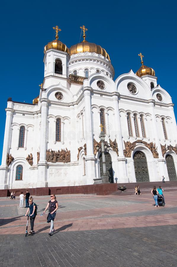 He Cathedral of Christ the Saviour facade in Russian capital during the midday, people go sightseeing. Moscow, Russia-May 27, 2018: The Cathedral of Christ the royalty free stock photos