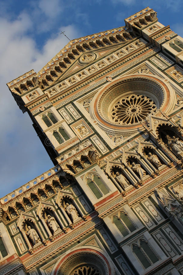 Cathedral of Florence. Front facade in warm sunset light stock image