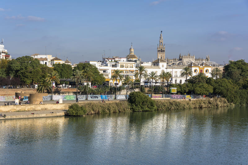 Cathedral, Giralda Tower and the Guadalquivir river in Sevilla, Spain. stock photo