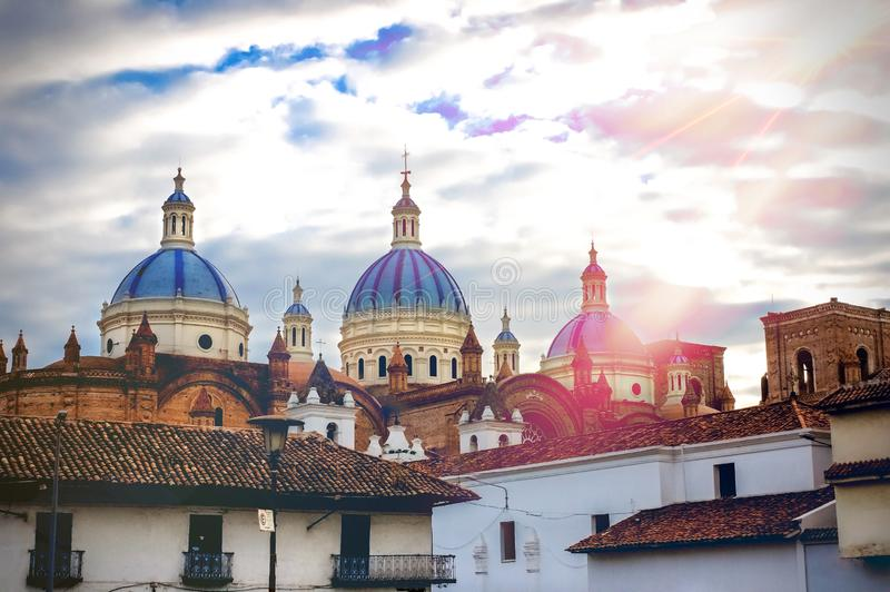 The Cathedral of the Immaculate Conception in Cuenca, Ecuador. With cloudy sky after a thunderstorm stock image