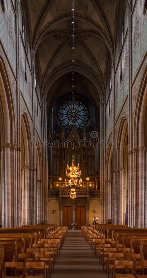 Cathedral nave in Uppsala, Sweden. Symetric shot of the cathedral nave in Uppsala, Sweden stock photo