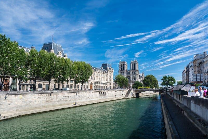 The Cathedral Notre-dame de Paris. Paris, France - August 13, 2016: The Cathedral Notre-dame de Paris and the river Seine. Notre-Dame is a medieval Catholic stock image