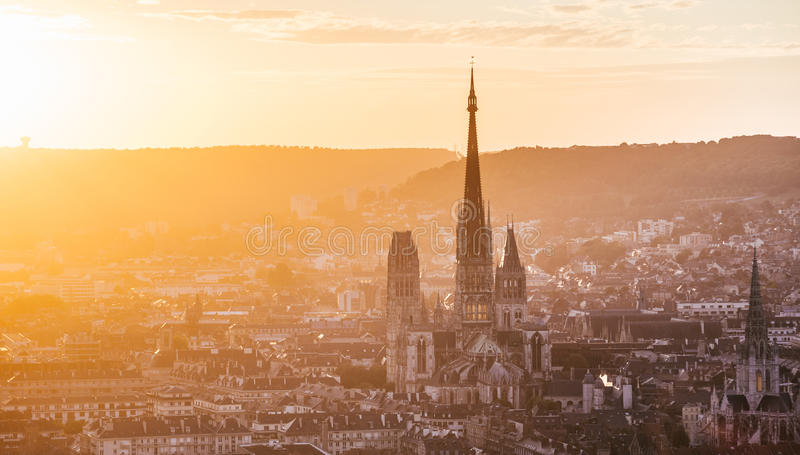The cathedral Notre-Dame and Rouen at sunset. In back light. Taken from the Sainte-Catherine Hill stock photo