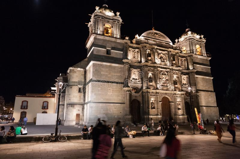 Cathedral of Our Lady of the Assumption, illuminated at night, O. OAXACA, MEXICO - MARCH 7th, 2012: People relaxing near the main Oaxaca Cathedral of Our Lady of stock images