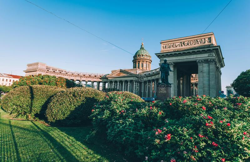 The Cathedral of Our Lady of Kazan in Saint-Petersburg. Summer time in Saint-Petersburg, green grass and bushes of roses, blue sky. Sunny day stock image
