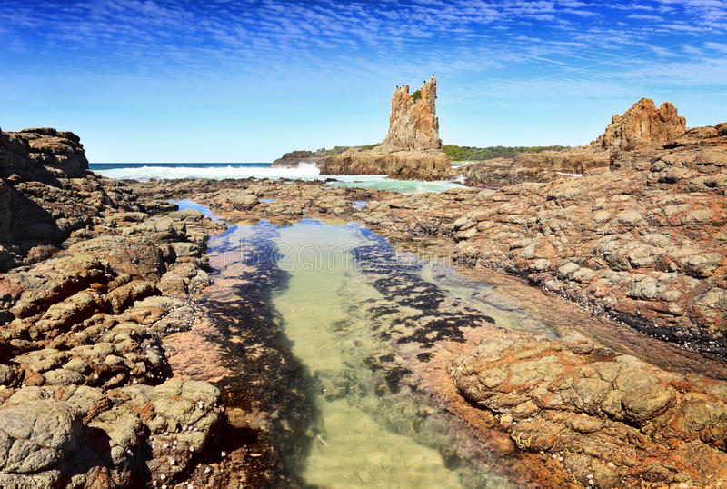 Cathedral Rock Kiama. Downs Australia. There is motion in the fish swimming in the rock pool stock images