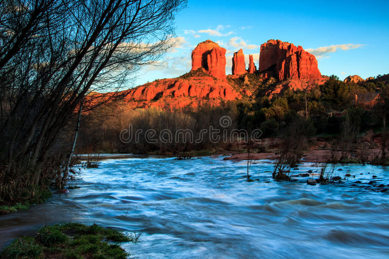 Cathedral Rock Sedona. This image of Cathedral Rock was captured early in the spring. Recent heavy rains had flooded Oak Creek in the foreground. Cathedral Rock royalty free stock photos