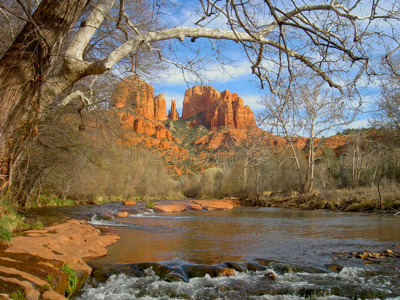 Cathedral Rock. View of Cathedral rock and stream flowing under a tree royalty free stock images