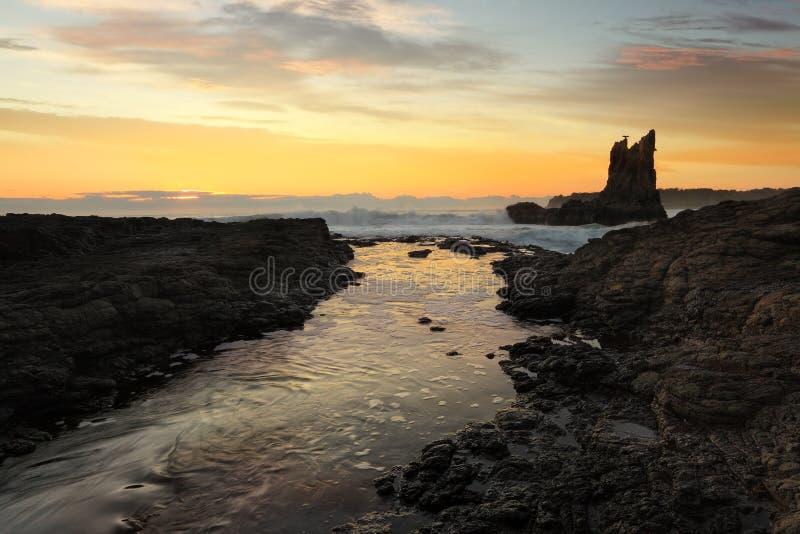 Cathedral Rocks, Kiama, Australia. Waves crashing around Cathedral Rock at sunrise, south coast, NSW, Australia stock photos
