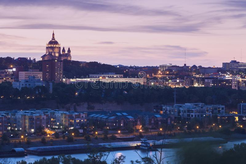 Cathedral of Saint Paul. And city panorama at evening. St. Paul, Minnesota, USA stock photo