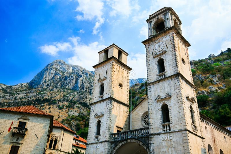 Cathedral Saint Tryphon is Roman Catholic cathedral in old town of Kotor, Montenegro. Lovcen mountain at background. stock images