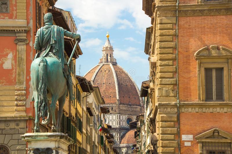 Cathedral of Santa Maria del Fiore and Monument of Cosimo de Medici. View from the Piazza of the Santissima Annunziata. royalty free stock photo