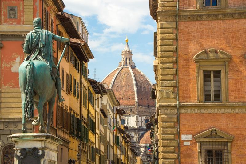 Cathedral of Santa Maria del Fiore and Monument of Cosimo de Medici. View from the Piazza of the Santissima Annunziata. royalty free stock photography
