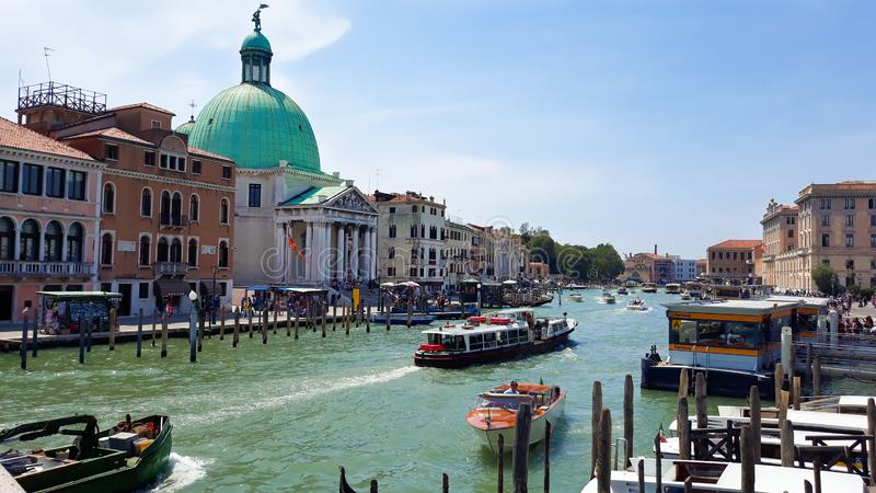 Cathedral Santa Maria della Salute and boats on Grand canal. In Venice royalty free stock photo