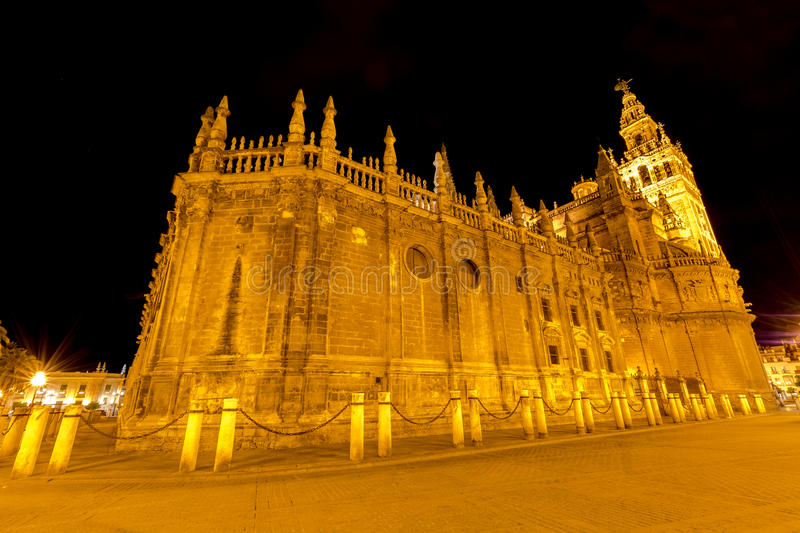Cathedral of Seville by night stock photography