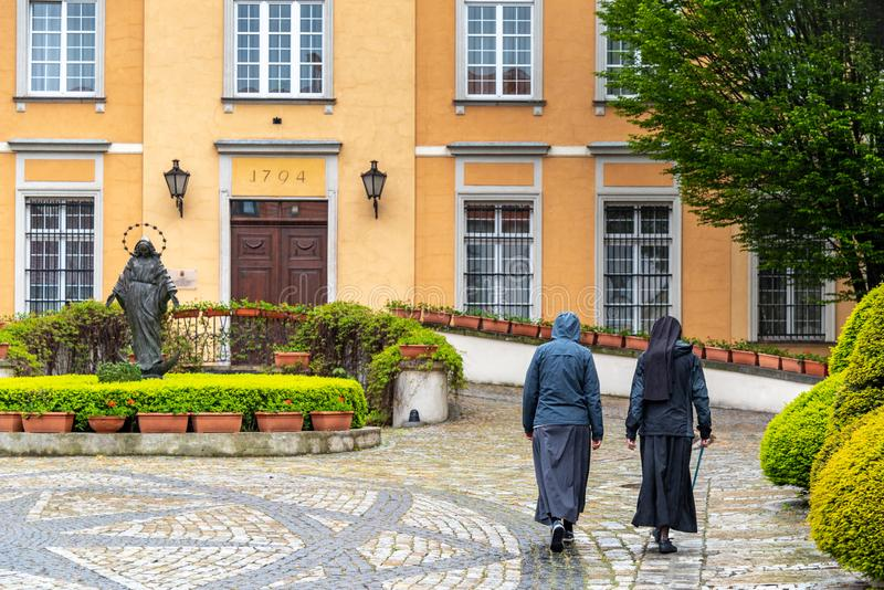 The Cathedral of St. John the Baptist in Wrocław, with nuns walking to the Nunnery located in the Ostrów Tumski district royalty free stock photo