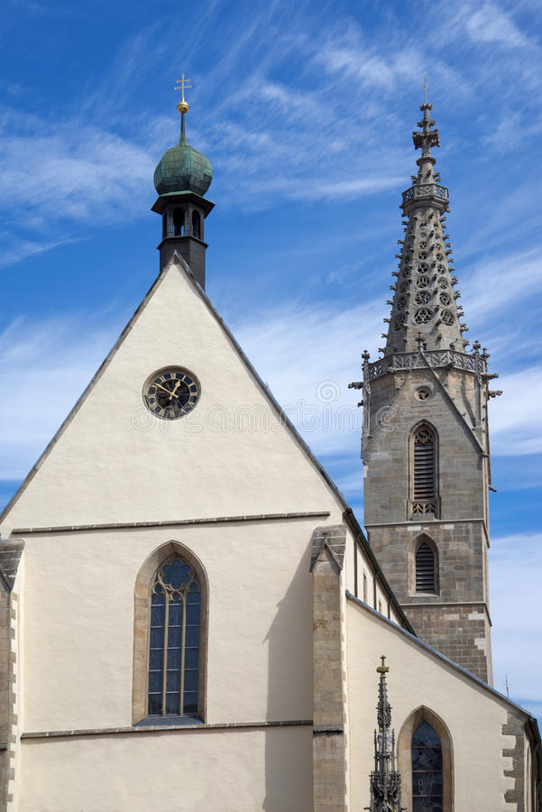 Cathedral of St. Martin in Rottenburg. Germany. Taken in vertical format against blue and white sky stock image
