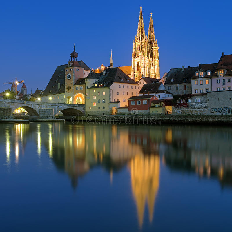 Cathedral and Stone Bridge in Regensburg at evening, Germany royalty free stock photos