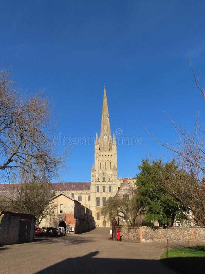 Norwich Cathedral on a spring day. He cathedral was begun in 1096 and constructed out of flint and mortar and faced with a cream-coloured Caen limestone. A Saxon stock image