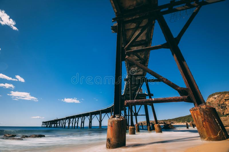 Catherine hill bay old coal pier stock image