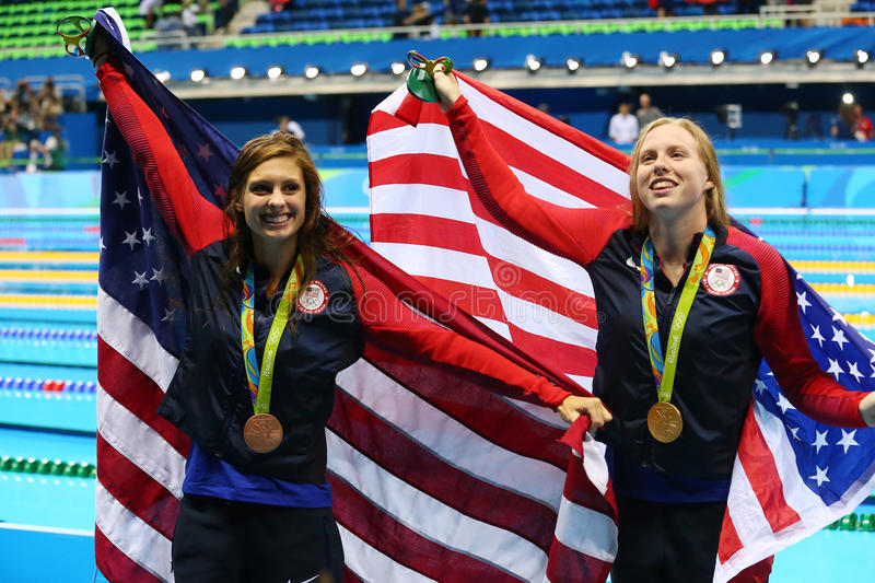 Catherine Meili L and Lilly King of the United States celebrate after Women`s 100m Breaststroke Final of the Rio 2016 Olympics. RIO DE JANEIRO, BRAZIL - AUGUST 8 royalty free stock image