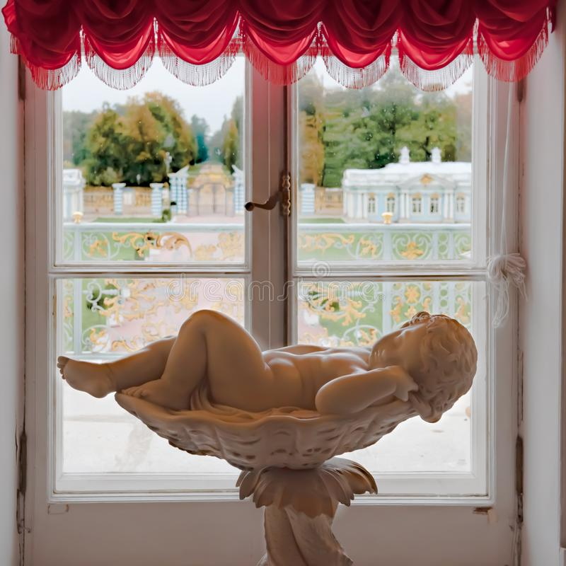 Free Catherine Palace, Awaking Cherub Laying In Bowl In Front Of Window With View To Park Of Catherine Palace, St. Petersburg, Russia Stock Photos - 158356813