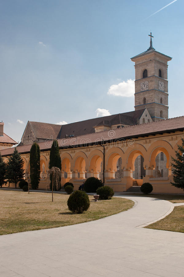 The Catholic Cathderal of Alba Iulia. The Catholic Cathedral of Alba Iulia seen from the courtyard of the Reunification Cathedral stock photo