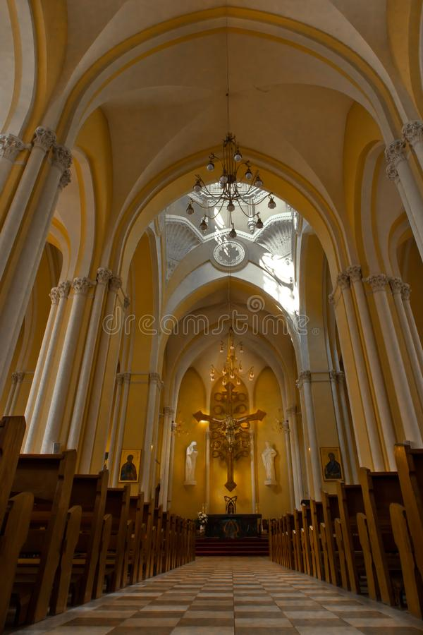 Catholic cathedral prospect and a luminous altar. stock photo