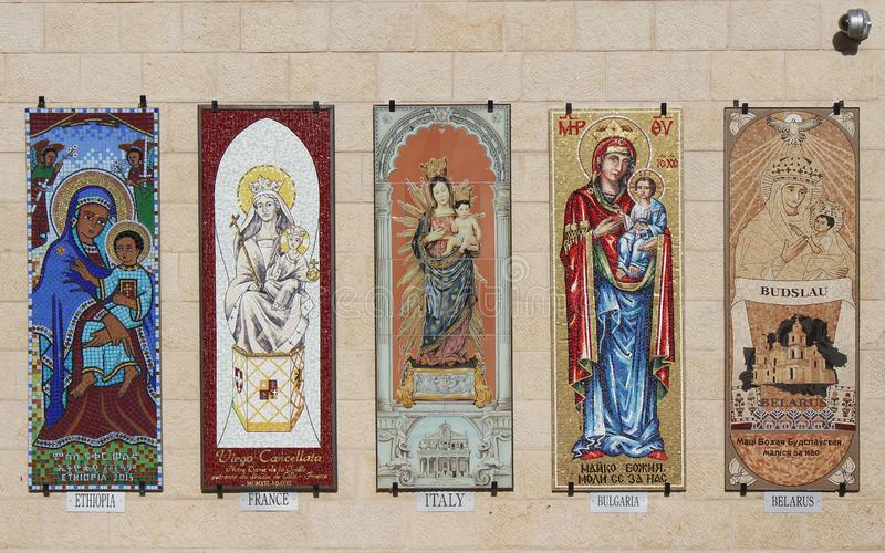 Mosaic icons of Virgin Mary. Catholic church of the Annunciation in Nazareth, Izrael. Indoor, artistic and architecture detail stock photo