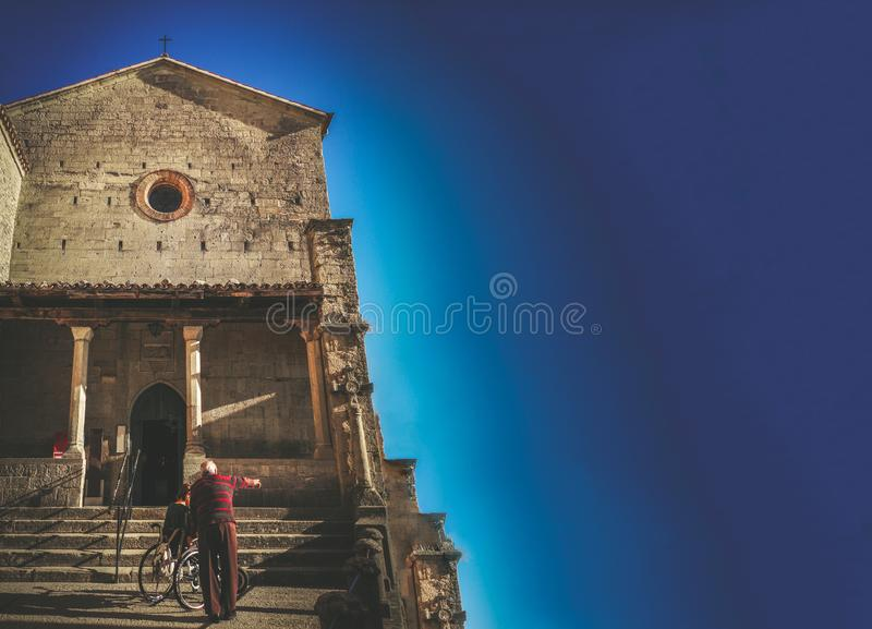 Catholic church assistance disabled volunteering elderly people help blue background copy space stock photo
