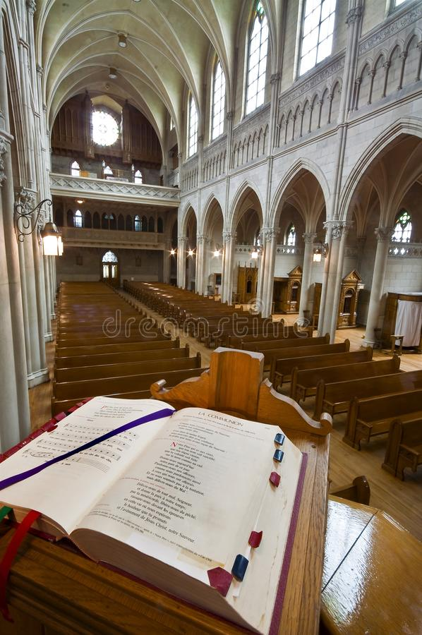 Catholic church interior from the pulpit. Catholic church interior, from the pulpit. Open Bible in foreground royalty free stock image