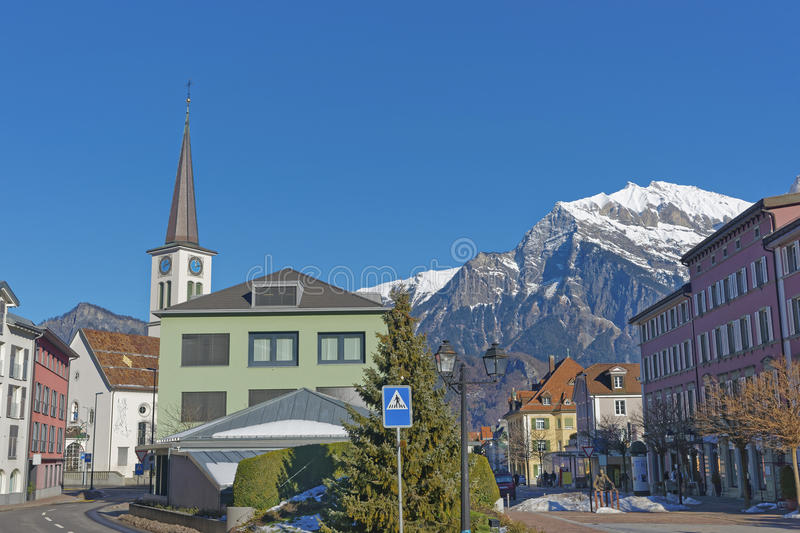 Catholic Church and Mountain in Bad Ragaz stock photography