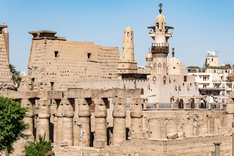Catholic Church and Muslim Mosque Tower religion Symbols together in Luxor temple.  stock photo