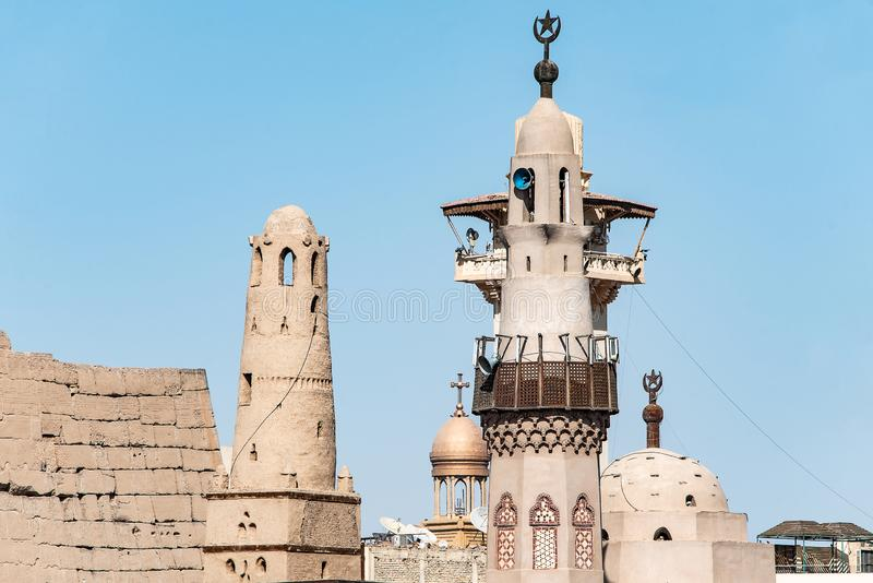 Catholic Church and Muslim Mosque Tower religion Symbols together in Luxor temple.  stock image