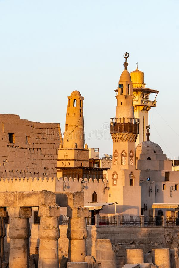 Catholic Church and Muslim Mosque Tower religion Symbols together in Luxor temple at sunset.  stock photography