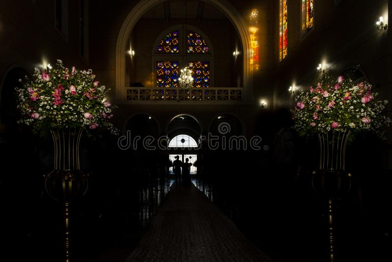 Catholic church during religious wedding ceremony - groom entering his mother royalty free stock image