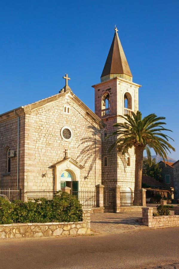 Catholic Church of Saint Roch in Donja Lastva village near Tivat city on a sunny winter day. Montenegro. Catholic Church of Saint Roch in Donja Lastva village stock image