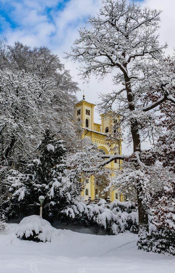 Catholic church in the small west Bohemian spa town Marianske Lazne. Marienbad - Czech Republic. Winter time stock photo