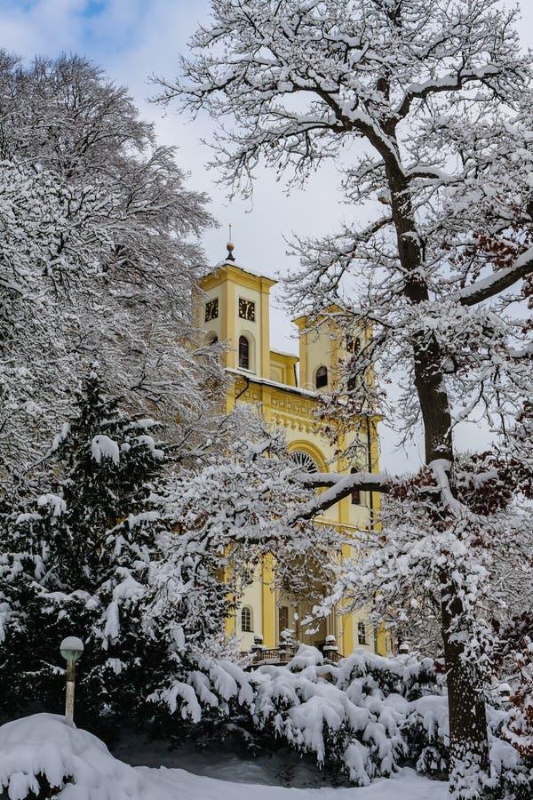 Catholic church in the small west Bohemian spa town Marianske Lazne. Marienbad - Czech Republic. Winter time stock image
