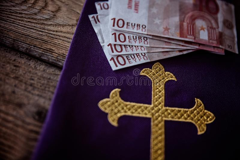 Catholic church symbols and Euro banknotes. Church and money stock photos