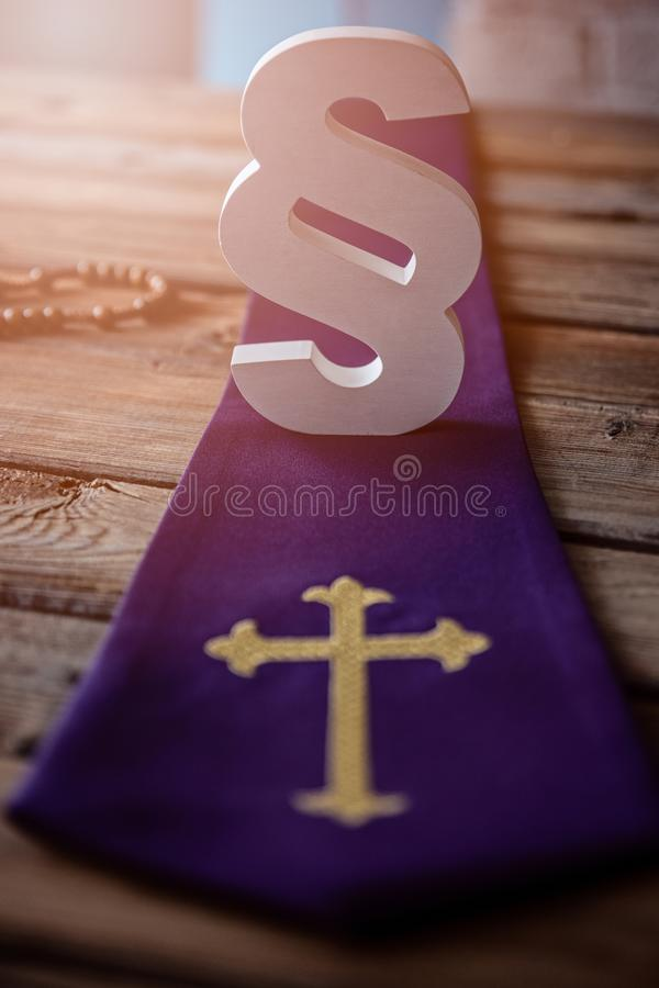 Catholic church symbols and wooden white paragraph symbol of law. Church and law stock image