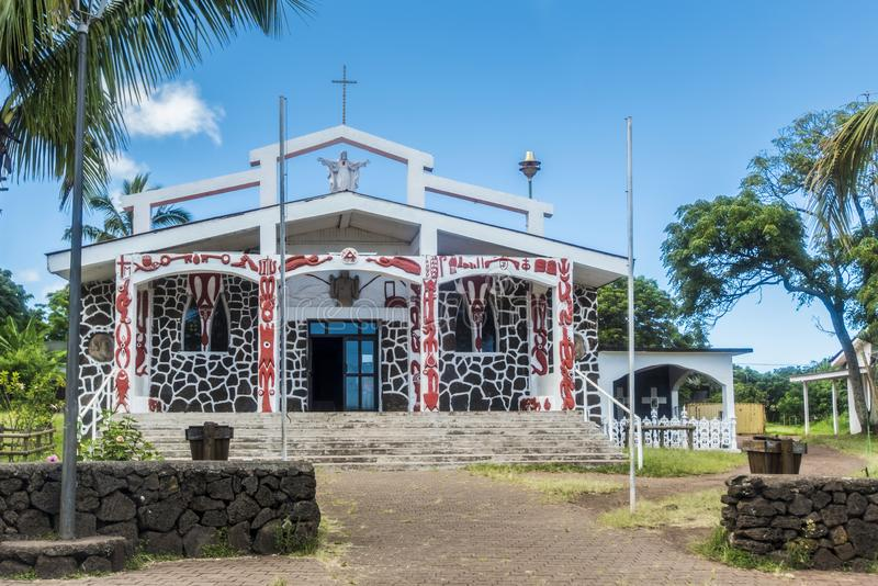 The church of Hanga Roa. The Catholic church with the walls covered with the religious symbols of the disappeared civilization stock photo