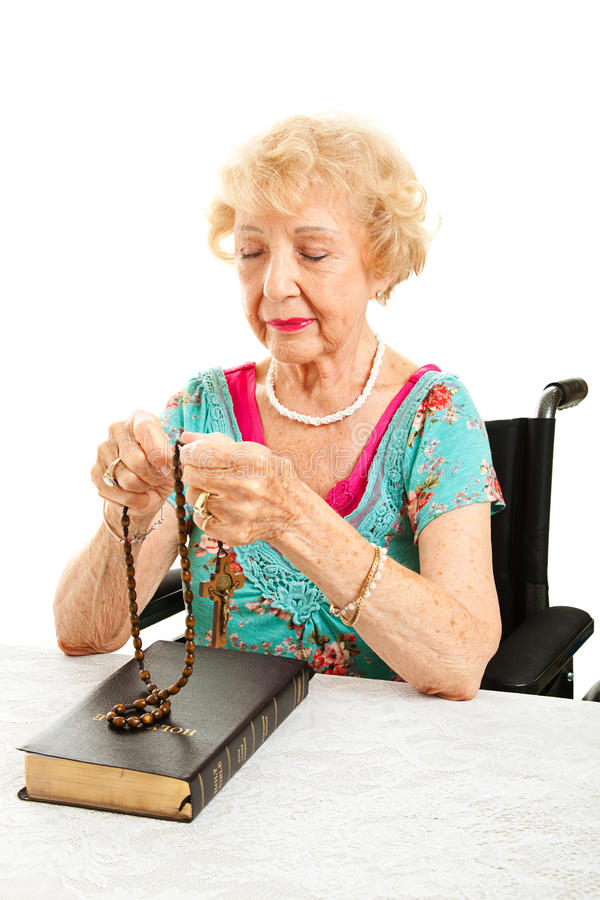 Download Catholic Grandmother Prays The Rosary Stock Photo - Image: 27538012