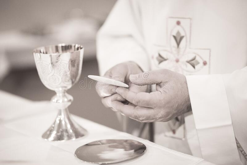 Catholic priest in church wedding marriage ceremony. Black and white artistic digital photo of Catholic priest in church wedding marriage ceremony stock images