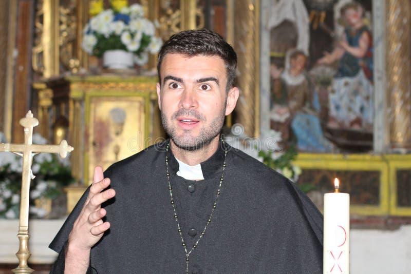 Catholic priest reading the Bible.  royalty free stock image