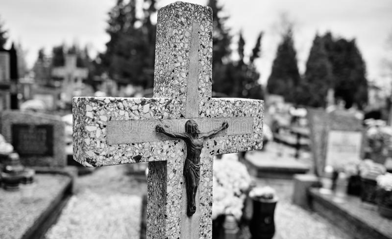 Catholic religious symbols. Catholic religious symbols on the Catholic cemeteries in Poland. Artistic look in black and white royalty free stock images