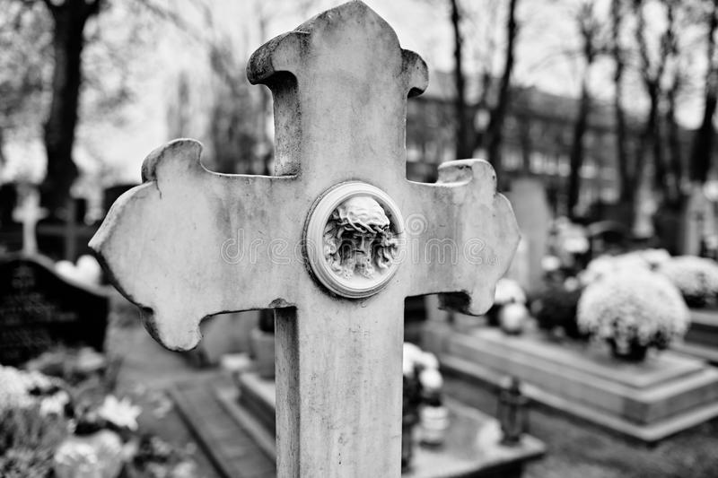 Catholic religious symbols. Catholic religious symbols on the Catholic cemeteries in Poland. Artistic look in black and white stock photos