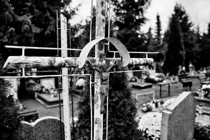 Catholic religious symbols. Catholic religious symbols on the Catholic cemeteries in Poland. Artistic look in black and white royalty free stock photography