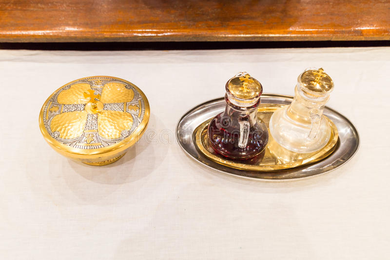 Catholics bread and wine in chalice on altar. In Church stock photos